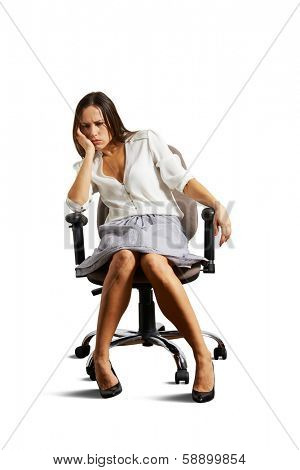 crestfallen woman sitting on the chair. isolated on white background