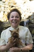 stock photo of grandma  - Portrait Of Family Happy Grandma And Dog At Home - JPG