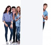 image of fools  - group of casual people fooling around and presenting a blank board on white background - JPG