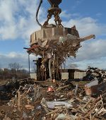 image of scrap-iron  - Pulling scrap metal with electromagnet for recycling - JPG