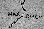stock photo of breakup  - Symbol of broken marriage with crack in concrete and word - JPG