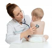 image of auscultation  - Doctor or nurse auscultating child baby patient spine with stethoscope physical therapy closeup composition on a white background - JPG
