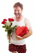 Humorous photo of a scruffy looking middle aged man in his underwear holding a bouquet of roses and