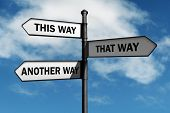 stock photo of confusing  - Crossroad signpost saying this way - JPG