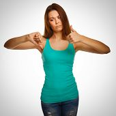 girl woman in a green shirt shows signs of yes and no, hand fing