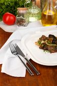 pic of liver fry  - Fried chicken livers on plate on wooden table close - JPG