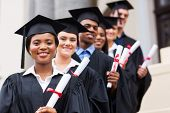 image of graduation gown  - happy group of university graduates at graduation ceremony - JPG
