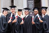 image of white gown  - group of young college graduates and professor at graduation - JPG