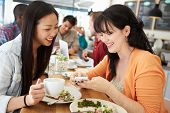 picture of lunch  - Two Female Friends Friends Meeting For Lunch In Coffee Shop - JPG