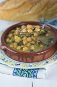 image of bengal-gram  - Stew of chickpeas and spinach with cod on a table with a tablecloth - JPG