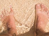 foto of wet feet  - Bare Feet On The Sand Beach Outside - JPG