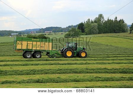 John Deere 6210R Agricultural Tractor And Krone Mx 350 Gl Forage And Discharge Wagon