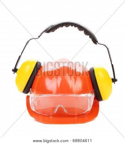 Orange safety helmet and protection headphones.