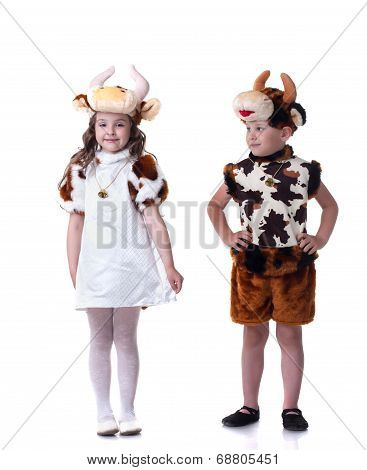 Funny little kids posing in carnival costumes