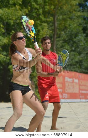 MOSCOW, RUSSIA - JULY 19, 2014: Mixed double of Spain in the match against Brazil during ITF Beach Tennis World Team Championship. Brazil won 2-1