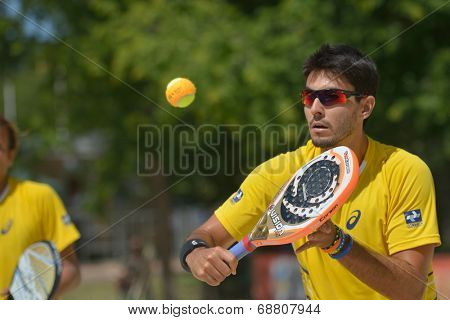 MOSCOW, RUSSIA - JULY 19, 2014: Marcus Ferreira of Brazil in the match against Spain during ITF Beach Tennis World Team Championship. Brazil won 2-1