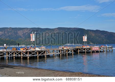 MARMARIS, TURKEY - APRIL 21, 2014: People resting in the lounge bar on the pier. City population increases 10 times during the tourism season, and its nightlife rivals anything on the Turkish coast