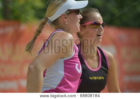 MOSCOW, RUSSIA - JULY 19, 2014: Woman double of Germany in the match against Japan during ITF Beach Tennis World Team Championship. Germany won in two sets