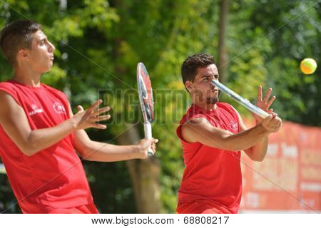 MOSCOW, RUSSIA - JULY 19, 2014: Man double of Spain in the match against Brazil during ITF Beach Tennis World Team Championship. Brazil won in two sets