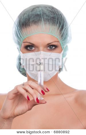 Beautiful Female Doctor With Syringe