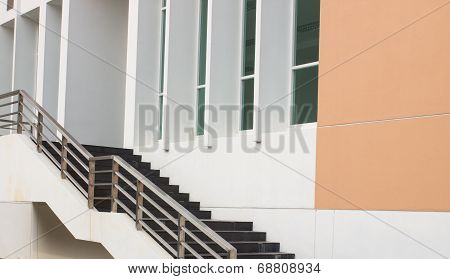 Modern Black Stairs And Metal Handrail