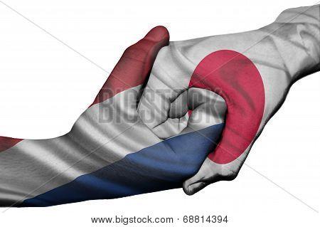 Handshake Between Netherlands And Japan