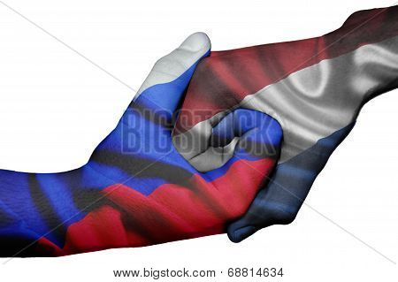 Handshake Between Russia And Netherlands