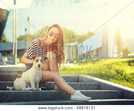 Trendy Hipster Girl with her Dog in the City