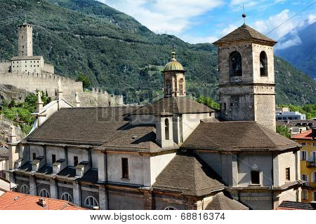 BELLINZONA, SWITZERLAND - July 4, 2014: The Collegiate Church and the Torre Bianca of Castelgrande.Switzerland. Two of Bellinzonas most famous landmarks and UNESCO World Heritage Site.