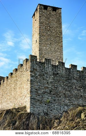 BELLINZONA, SWITZERLAND - July 4, 2014: The Torre Bianca (White tower) of the Castelgrande in Bellinzona, Switzerland. A UNESCO World Heritage Site, seen from Piazza del Sole.