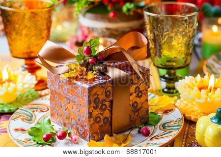 Gift box for autumn holiday on festive table