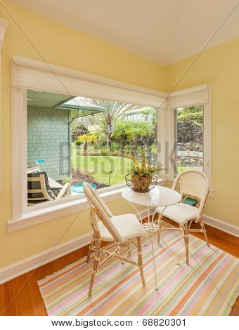 Bright and sunny breakfast table in classic home with wood floors