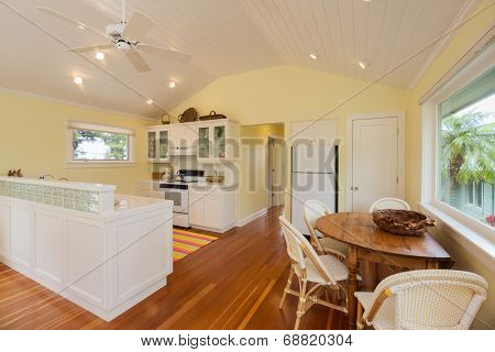 Beautiful kitchen and breakfast table in home with wood floors