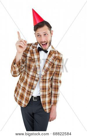 Geeky hipster in party hat on white background