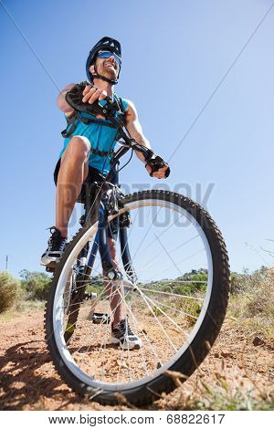 Fit cyclist riding in the countryside on a sunny day