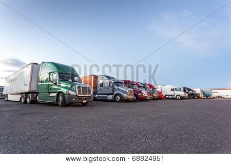 Many American Trucks On Parking Lot.
