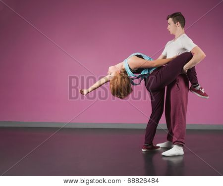Cool break dancing couple dancing together in the dance studio