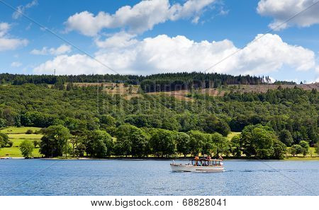 Summer day pleasure boat on Coniston water Lake District Engand uk