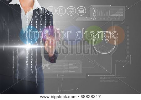 Businesswoman touching the words time for change on interface against grey vignette