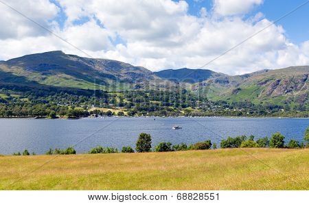 Coniston Water Lake District England uk with mountains and blue sky and white clouds beautiful day