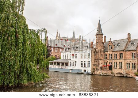 Canals And Brick Houses Of Bruges In Belgium Flanders