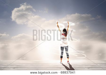 Cheering football fan against floorboards in bright sky