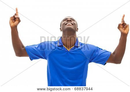 Excited football fan in blue cheering on white background