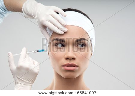 Caucasian woman getting cosmetic injection
