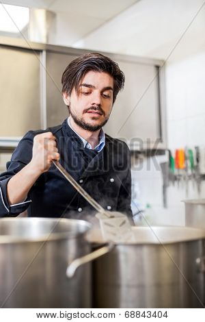 Chef Cooking A Vegetables Stir Fry Over A Hob
