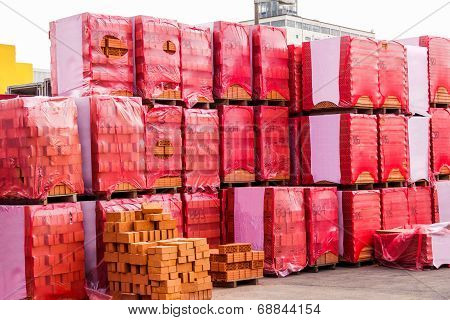 Red Clay Bricks Stacked On Pallets