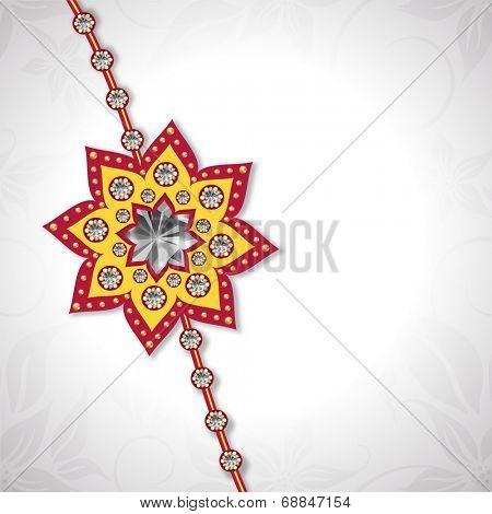 Beautiful floral design decorated rakhi on grey background for the occasion of Raksha Bandhan celebrations.