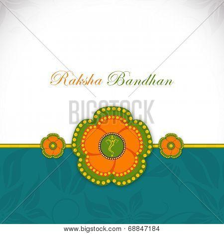 Beautiful colorful rakhi on floral decorated green and grey background on occasion of Raksha Bandhan celebrations.