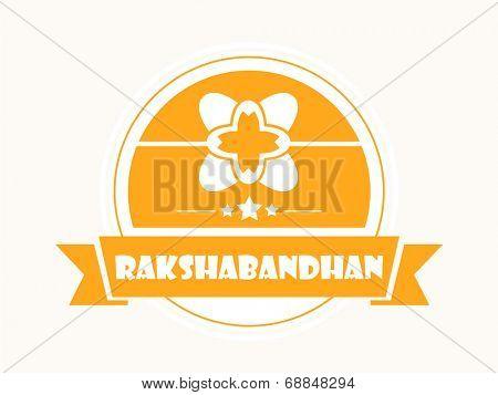 Beautiful yellow sticky with floral designed rakhi on beige background for the occasion of Raksha Bandhan celebrations.