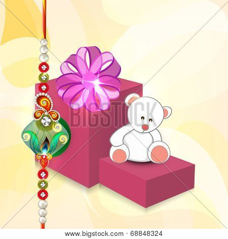 Big gift boxes and teddy bears with pearls decorated rakhi on shiny yellow background for Raksha Bandhan celebrations.